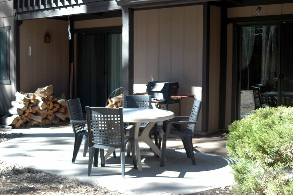 Back patio with gas bbq grill, table and chairs
