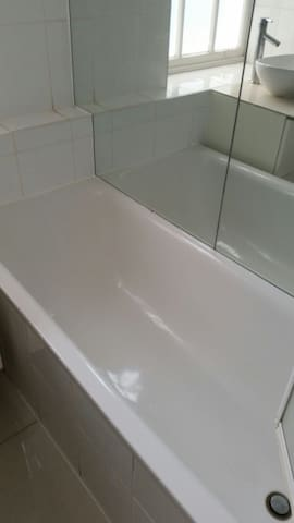 Bath with constant hot water and more mirrors