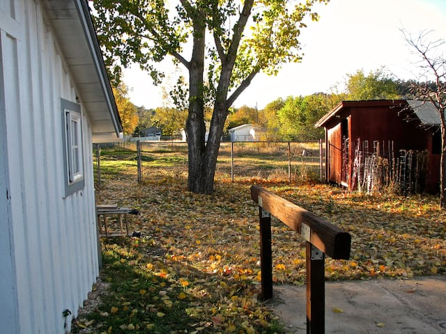 Backyard, tack room, hitching post, and (former) chicken coop