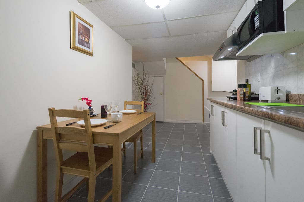 Kitchen area - NO STOVE, microwave oven and toaster, dinning table, fridge, plate, bowl, knife & fork