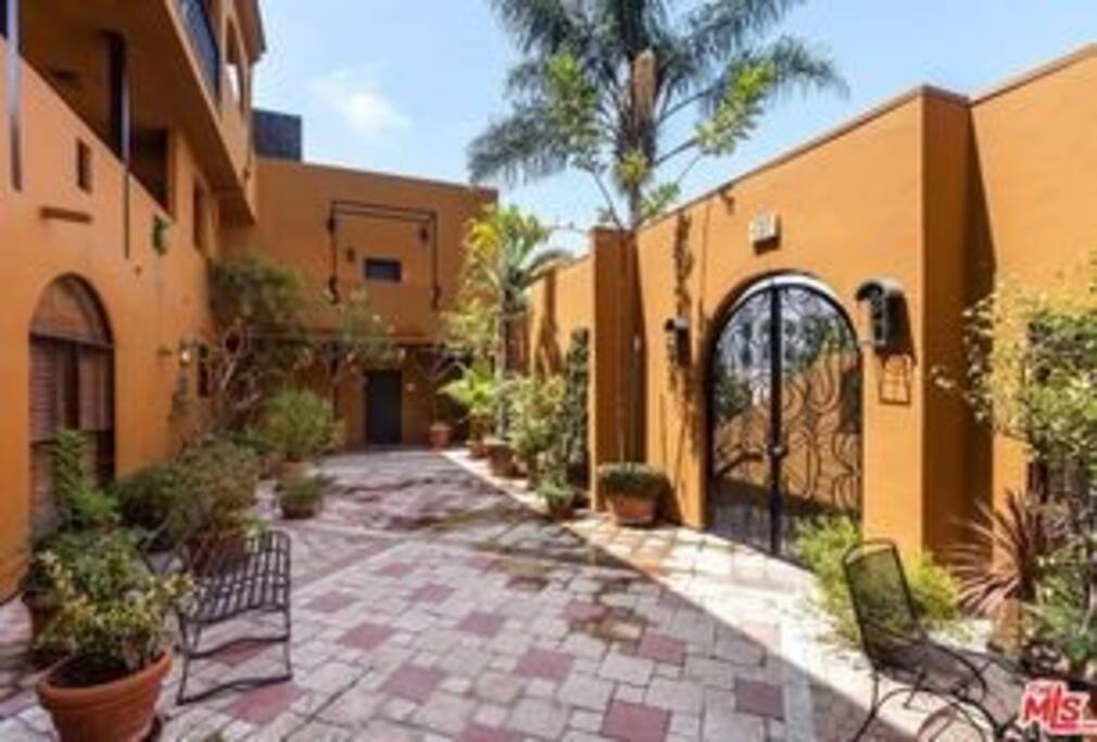 Gated (security code) entry-level courtyard.
