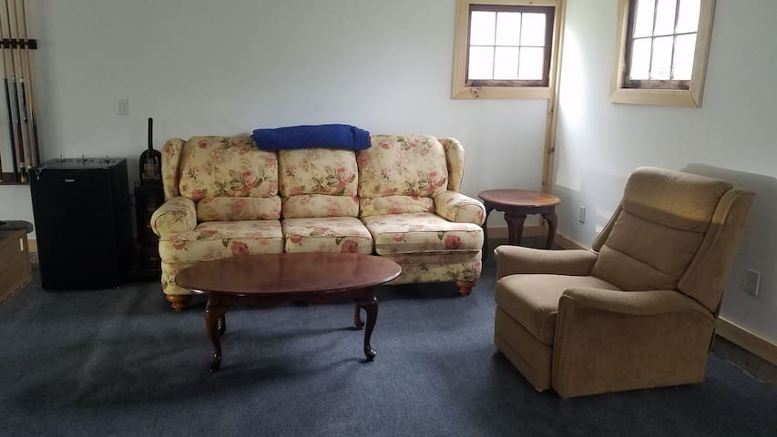 Comfy conversation pit in optional game room