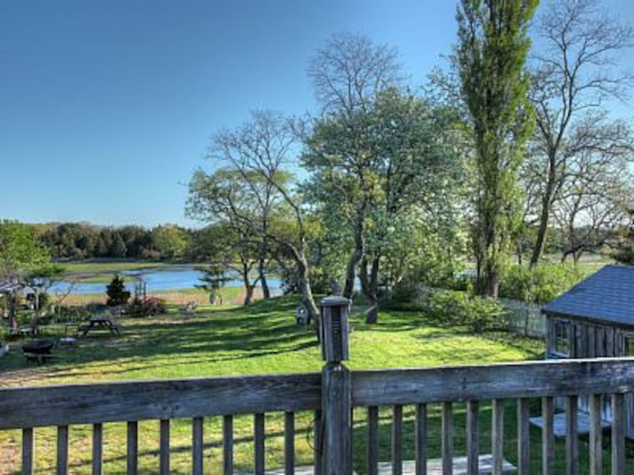 Deck over looking common areas. View of Marsh, gardens, picnic tables and hammock.