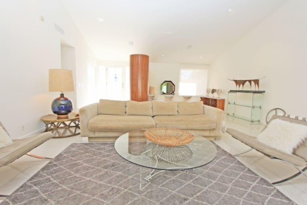 open living room with sunken bar