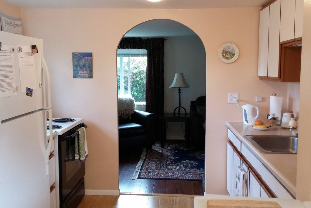 Looking from kitchen to living room. Fully equipped kitchen for preparing your own meals.