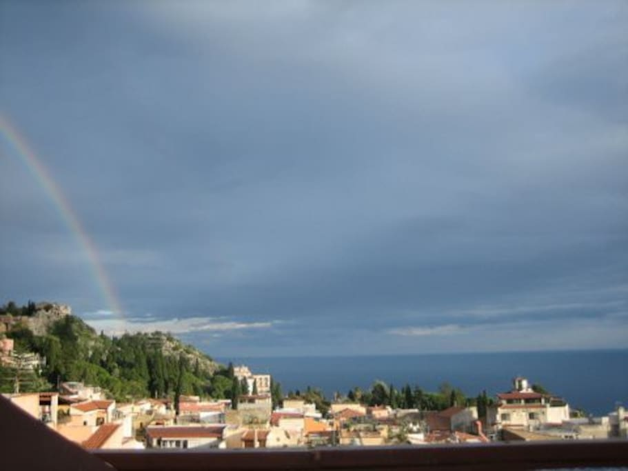 An evening storm with rainbow from terrace