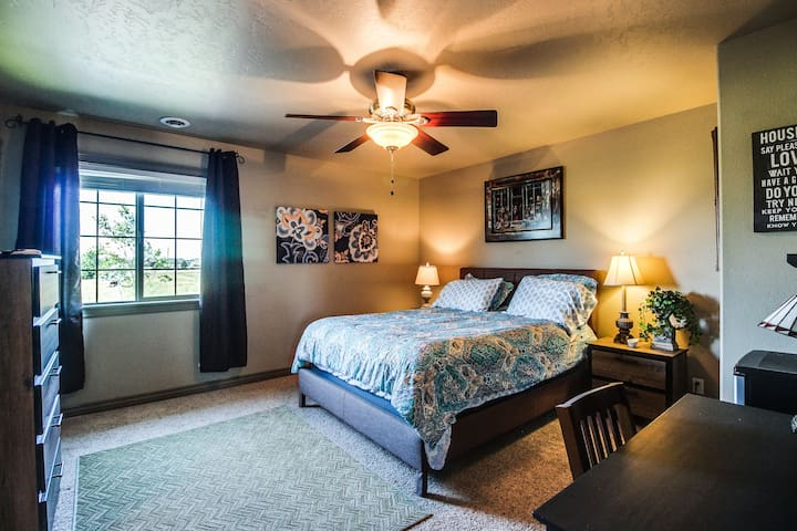 Large bedroom with walk in closet, private full bath, desk, internet, cable TV.