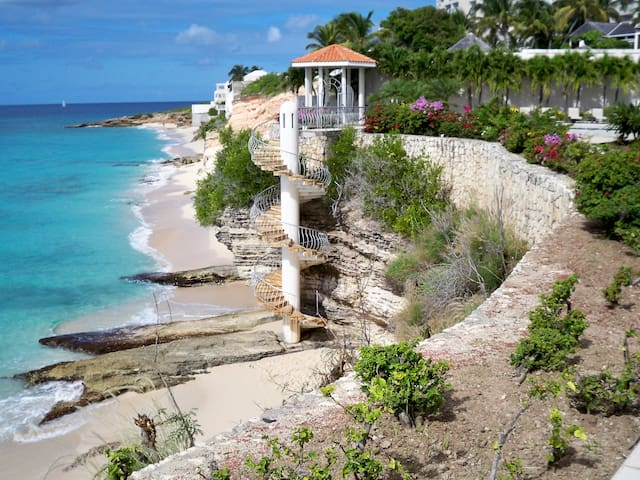 Spiral stairs to the beach