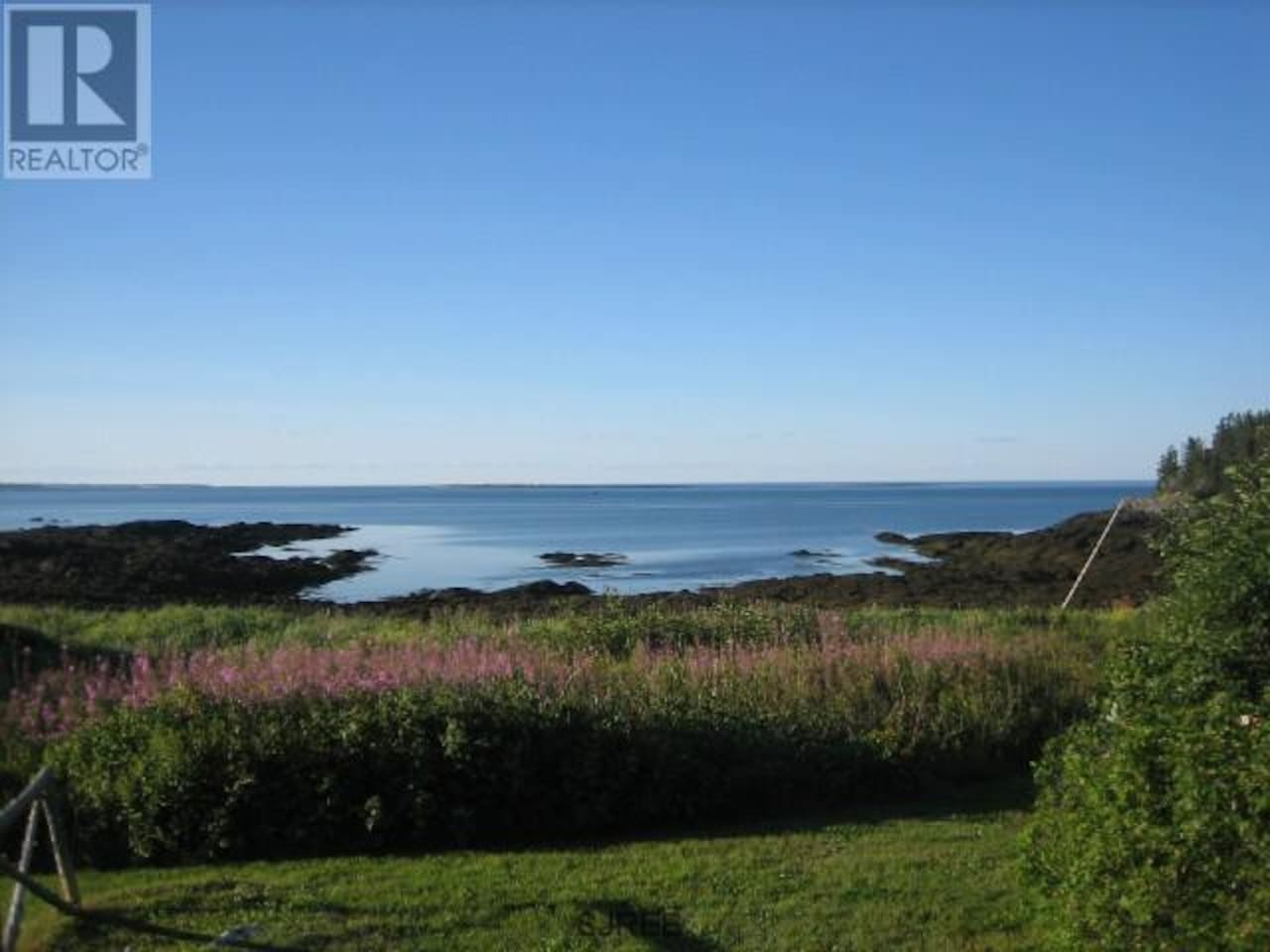 The view off the back deck at low tide: steps to the beach and ocean.