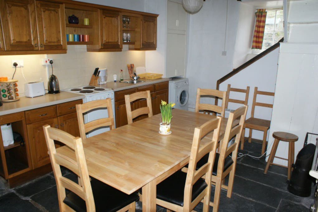 The kitchen has a log burner, electric hob and oven, dishwasher, fridge freezer, washing machine & tumble dryer