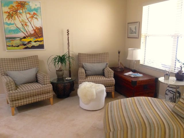 Sitting room in front of large window to plan the Open Houses that you're going out to see today!