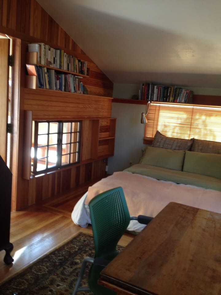 Third Floor Suite includes a Queen Size Bed (not futon) in a room filled with books and light, half bath, jacuzzi and deck.