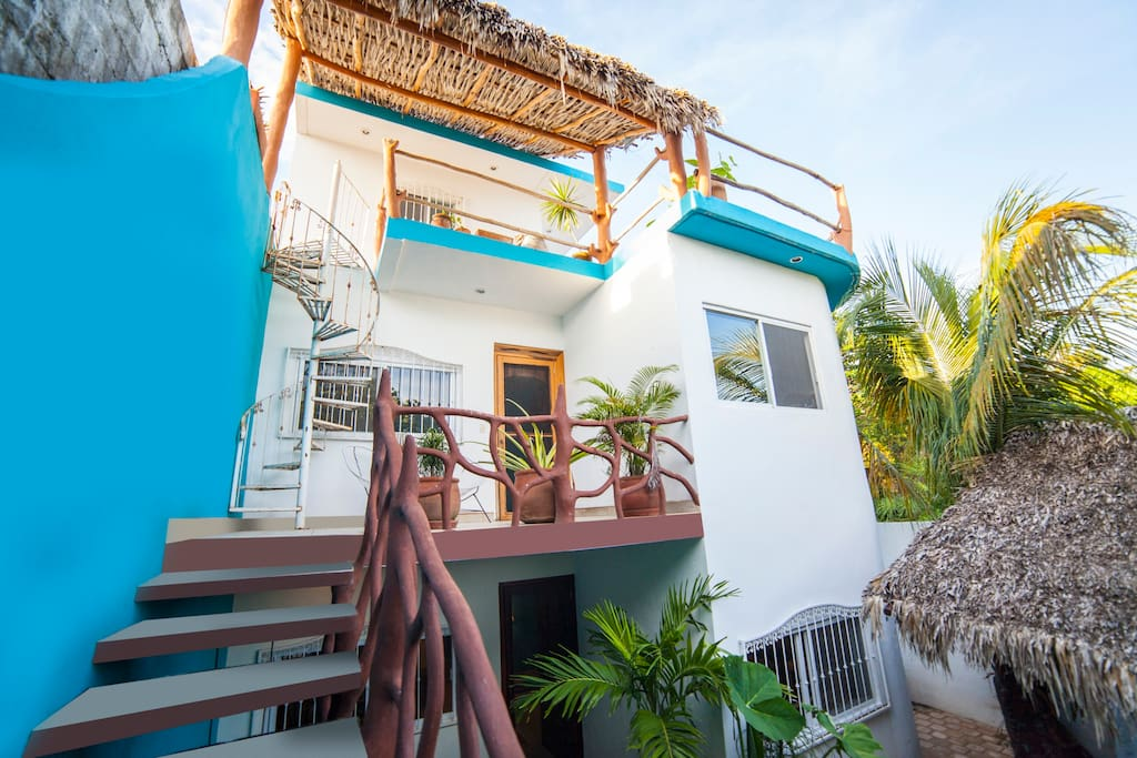 Exterior of second floor Mexican Caribbean Tulum town home.