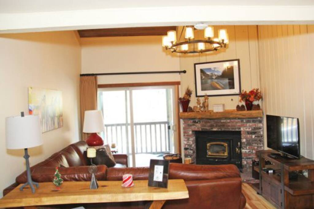 Mammoth Condo Rental Chamonix 60 - Living Room with Wood-stove and Outside Deck Access