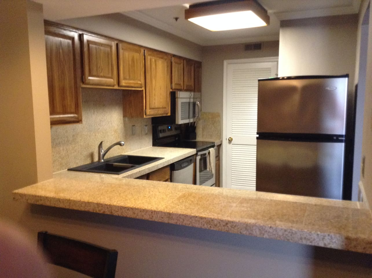 Granite countertops and full granite backsplash. Granite composite double sink. New SS Appliances. Solid wood cabinets with pull out shelves.