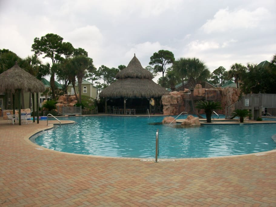 Large outdoor pool with island hot tub and tiki bar.  Separate indoor pool complex.