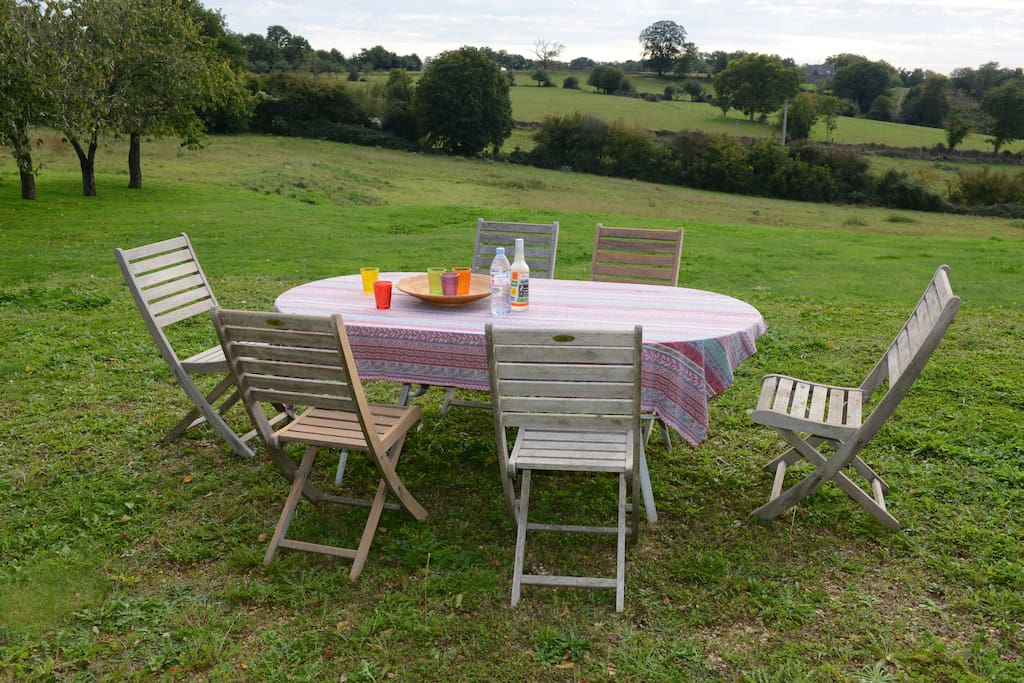 Outdoor dining looking over the tranquil Mayenne River valley