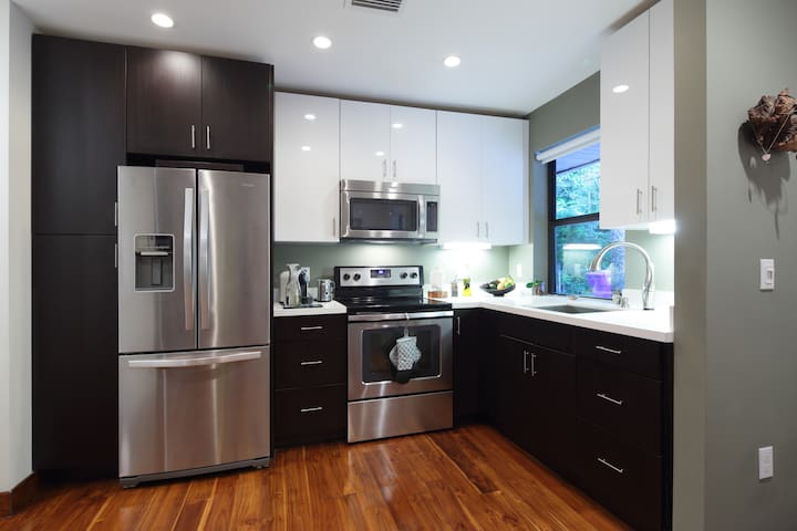 Fully equipped, brand new kitchen with stainless steel appliances & all cooking essentials.