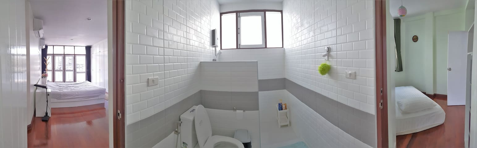 shared bathroom with connecting doors