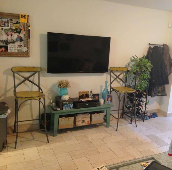 60-inch mounted flat screen TV in livingroom