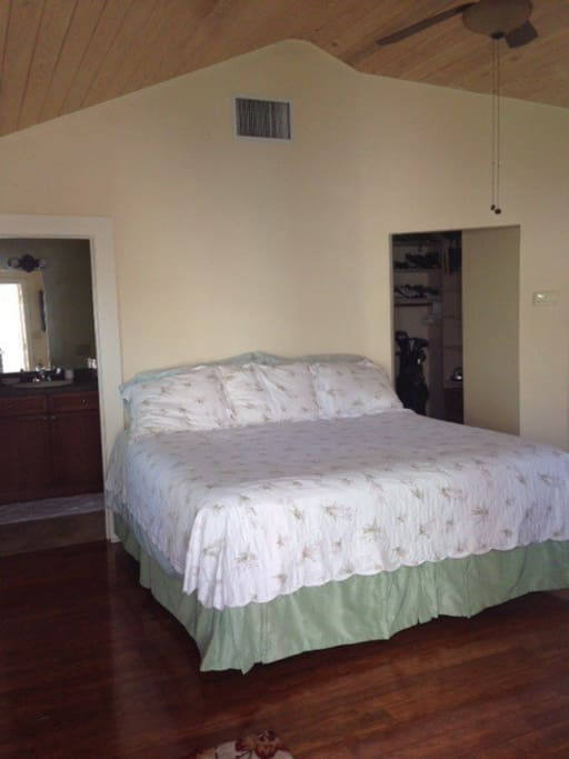 KIng size dual control bed, walk in closet, and full bath. Egyptian cotton sheets on bed.