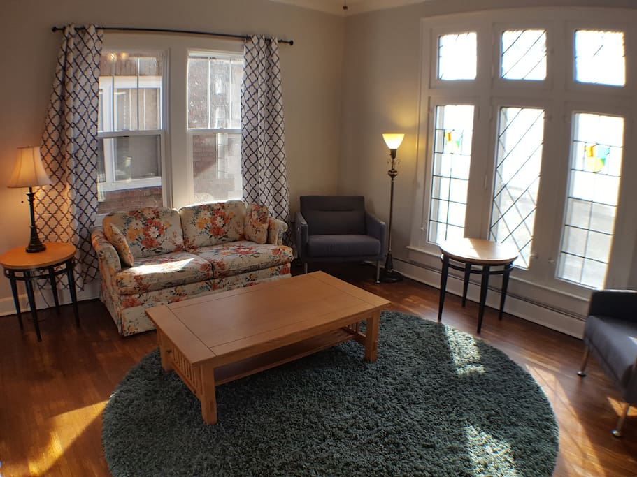 Living Room with stained glass windows facing the park