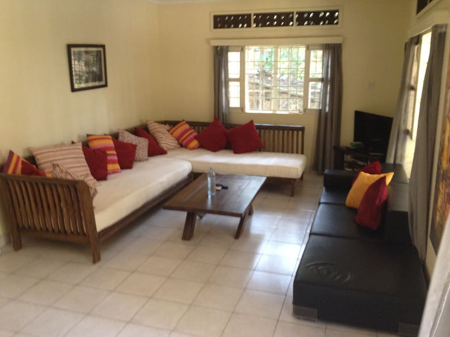 Living room, with comfortable lounge sofas.