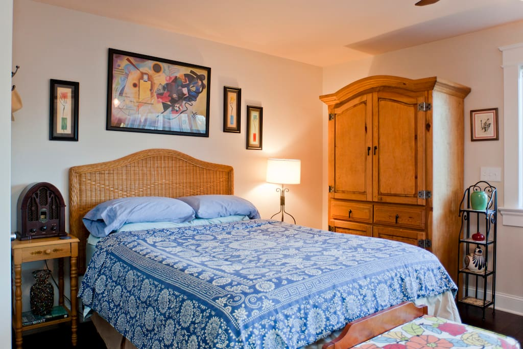 Bedroom with super-comfortable hotel-style Queen bed. Assortment of pillows & an armoire for your clothes.