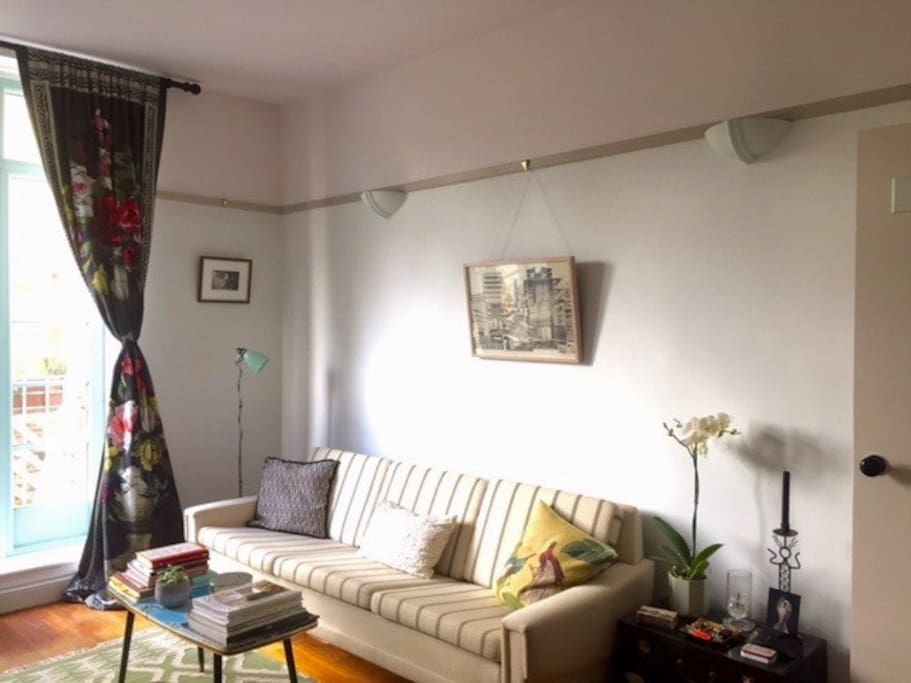 One side of the main room - with long sofa and coffee table.