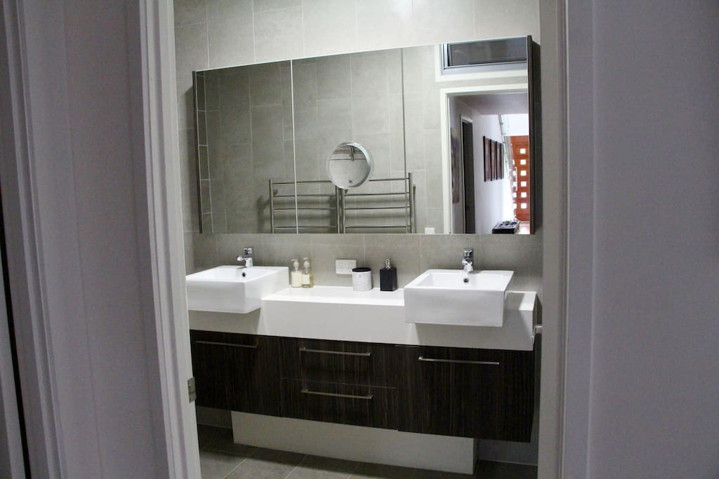 Bathroom, double vanity basins. Bath opposite shower.