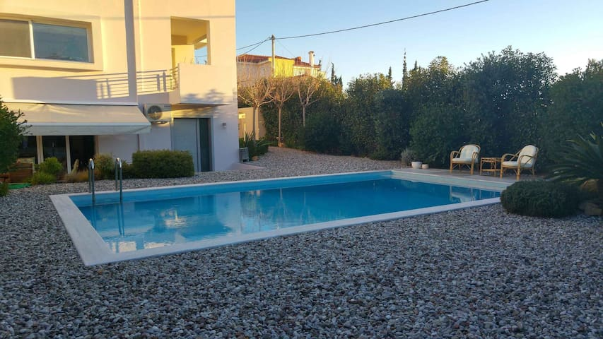 Luxurius groundfloor with pool near the beach. - Kalivia Thorikou - Wohnung