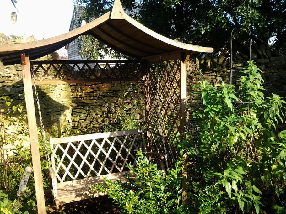 Walled garden with swing seat
