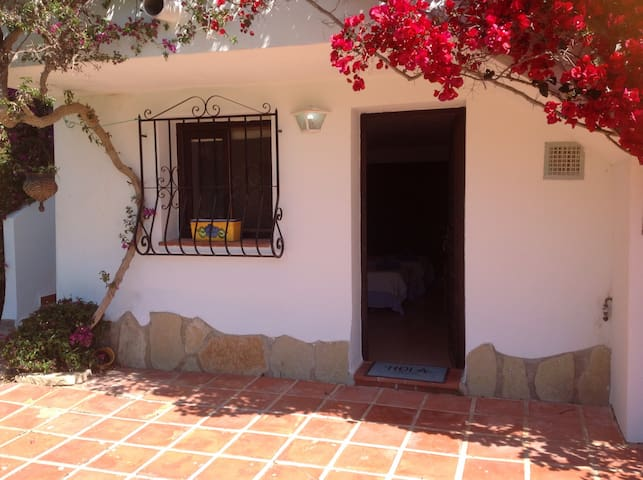 Studio Apartment   A beautifully presented, spacious and bright ground floor apartment.  It offers twin beds, kitchenette (fully equipped), eating area and separate shower room.  Use of wifi, TV, microwave and fridge/freezer. An outside terrace, set in pr