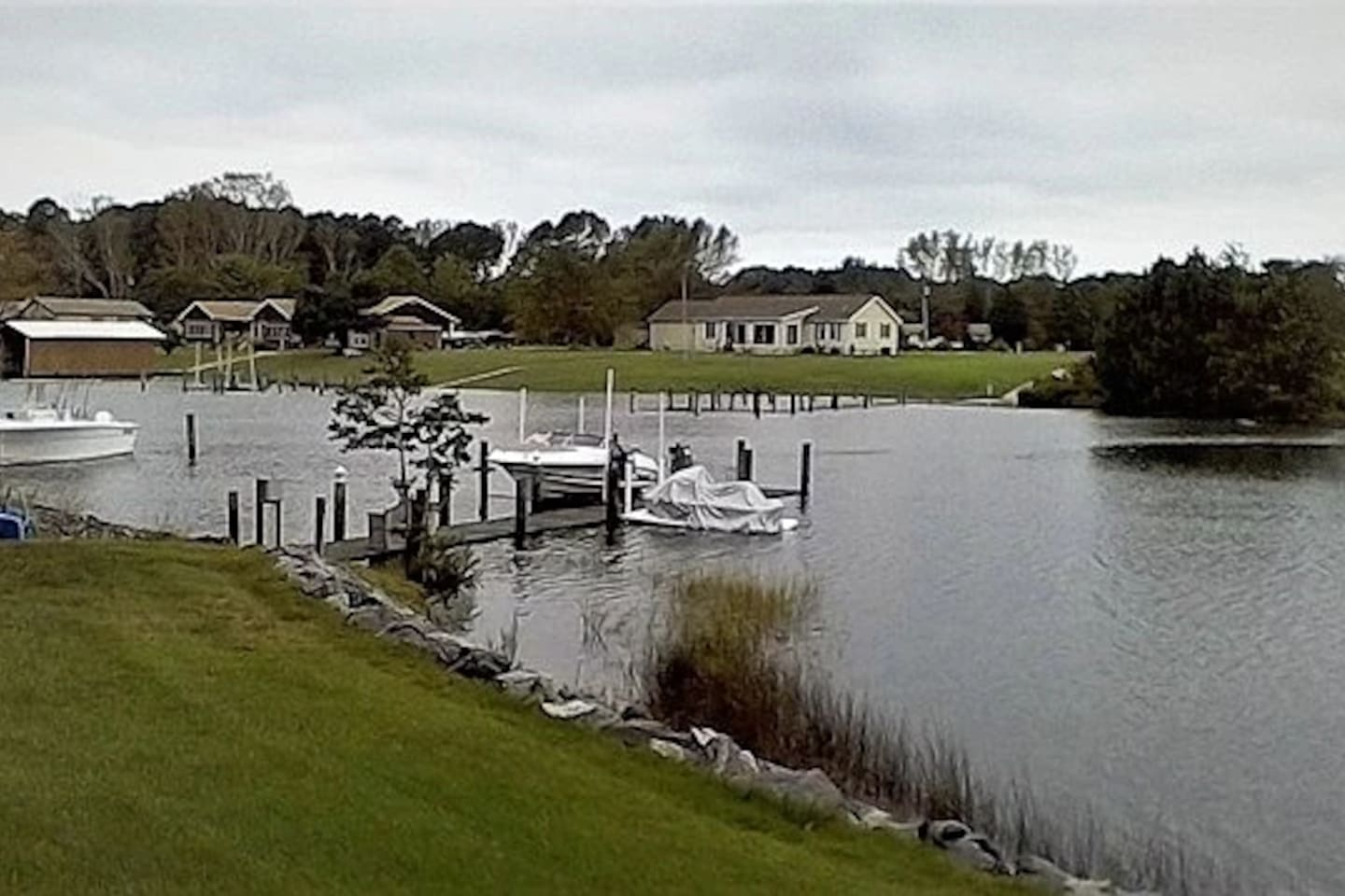 Private dock with boat lift and jet ski dock