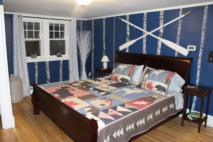 Master bedroom has a comfortable King bed.  It is decorated with birch trees, which are seen throughout the state of Maine.
