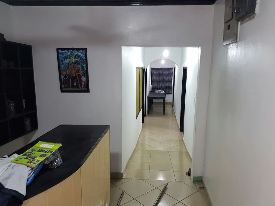 Corridoor showing entrance to 4 bed rooms with multiple beds. Also connects to two separate toilets and two major bathrooms. Wifi easily accessible around bar area.