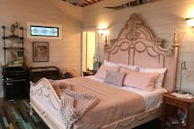 You are going to feel like royalty waking up in this pink hand painted king size bed with a luxury mattress!
