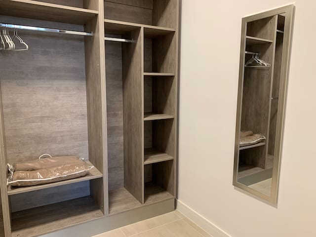 Large walk-in wardrobe with full length mirror