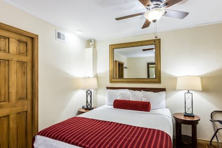 Queen size bed in private bedroom