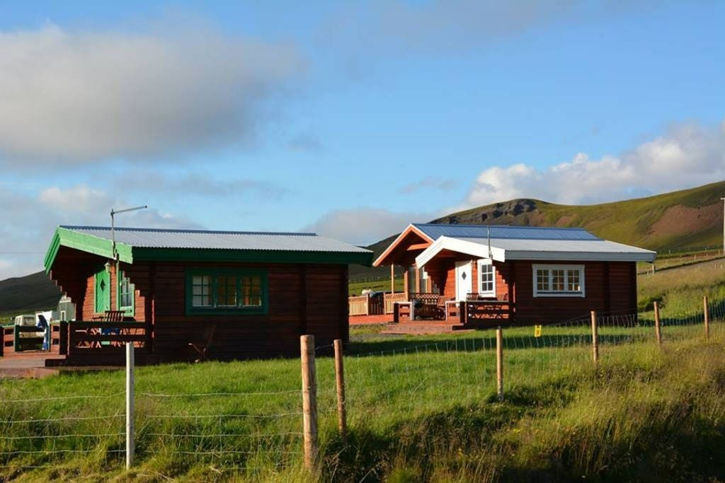 The three wooden cottages