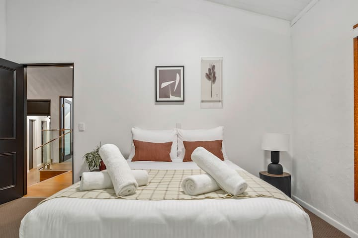 A comfortable queen-sized bed can also be found in the fourth bedroom, along with an ensuite bathroom and wardrobe space.