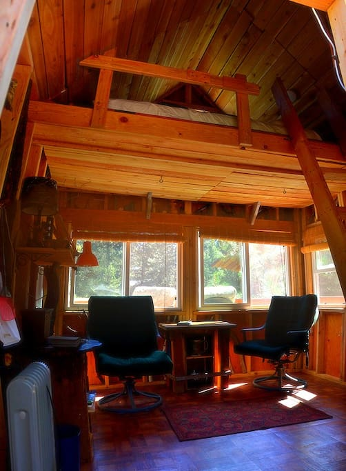 Inside the treehouse with the loft above.
