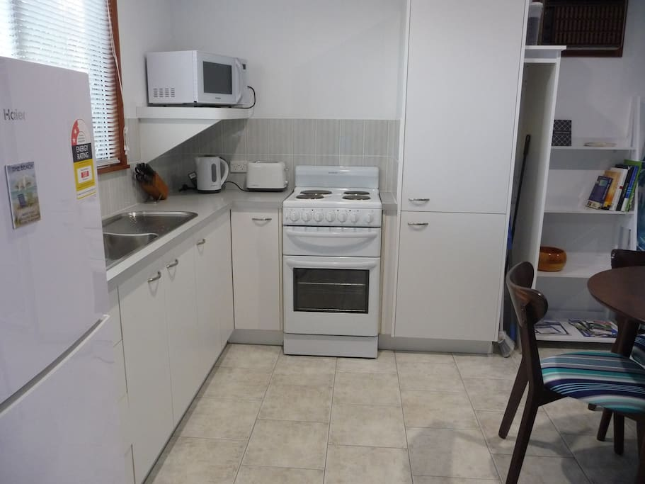 Kitchen with stove, microwave, full sized fridge, small appliances, crockery, cutlery and kitchen equipment supplied.