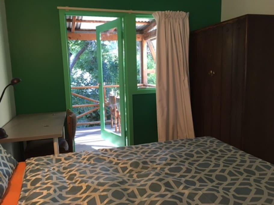 Your bedroom is a quiet and light room with a balcony overlooking the green back garden.