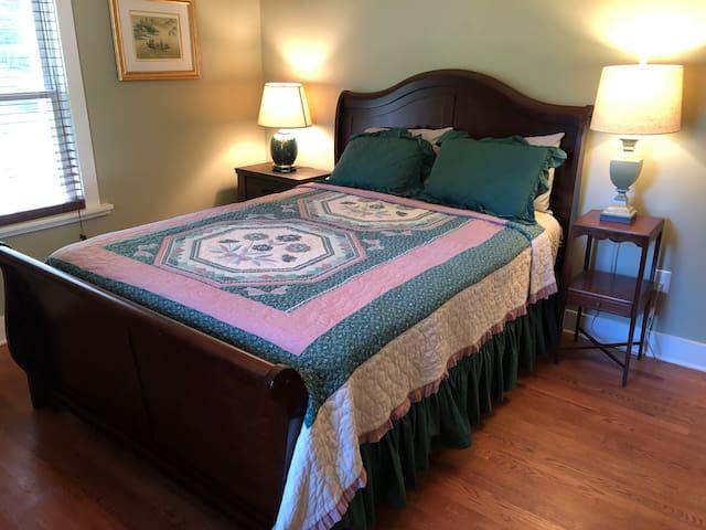 Guest bedroom has a queen pillow top mattress on a sleigh bed.