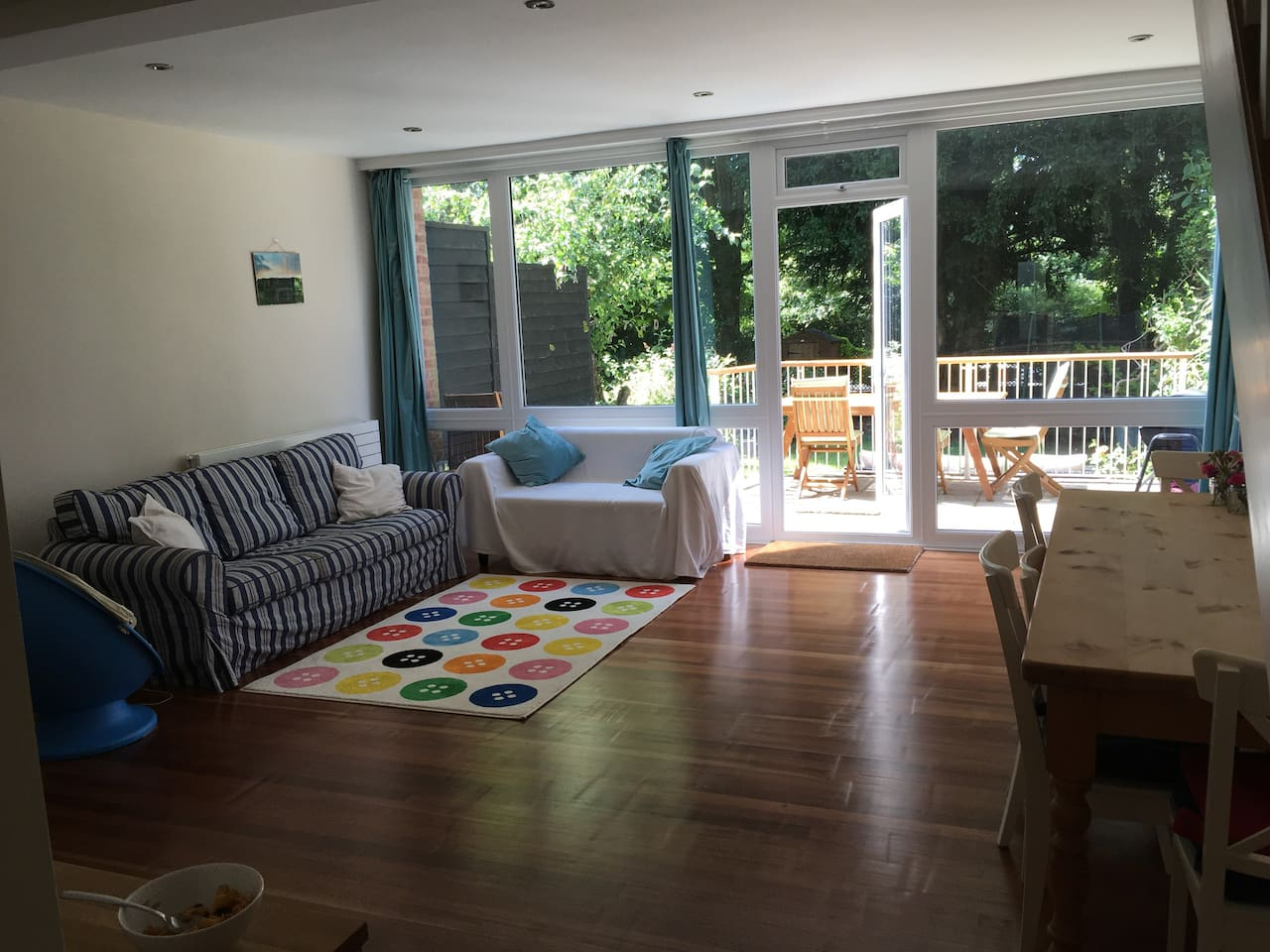Spacious, bright, open plan living room / dining room looking out onto garden