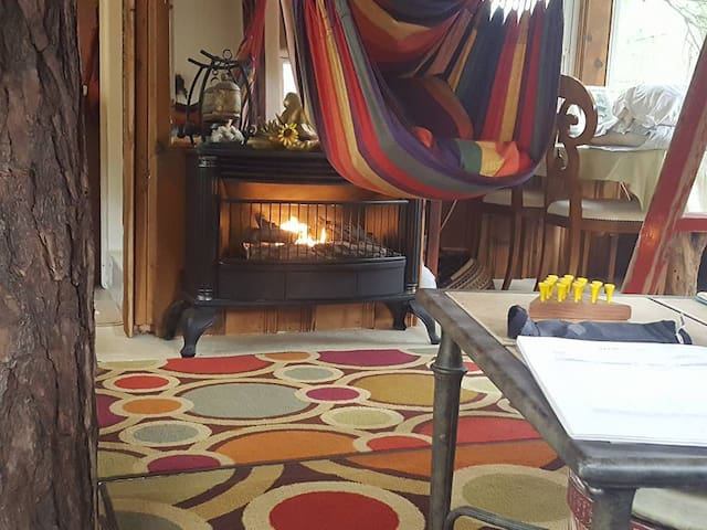 Yes we have heat and are open year round! Our cozy propane fireplace and space heaters make your stay enjoyable in the cooler months and a/c units in the summer pamper you. Book your winter sacred getaway now.
