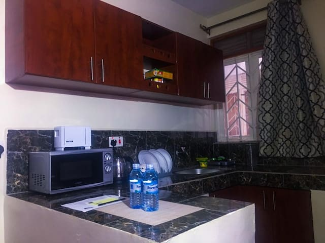 fully stocked kitchen with a microwave,bread toaster,electric kettle,fridge,gas cooker and general kitchen ware