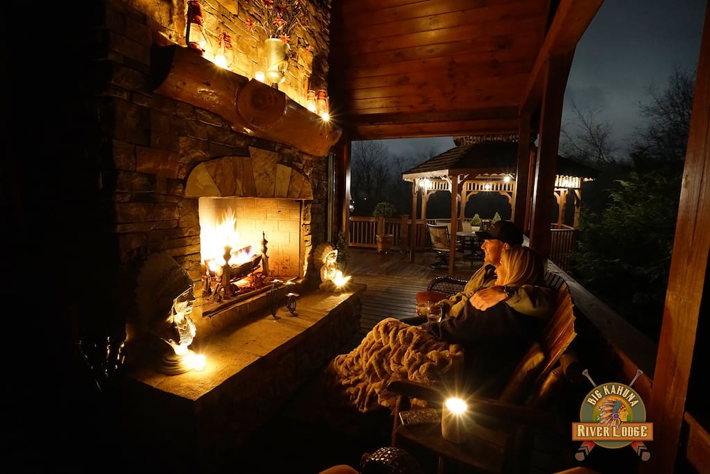 Night view of outdoor fireplace on top balcony off family room & master suite