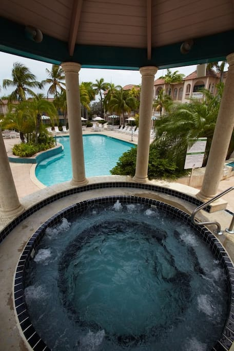 4 person jacuzzi overlooking the front pool..